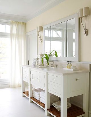 white bathroom console with mirror above