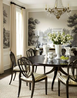 dining room with mural scenery wallpaper and a crystal chandelier