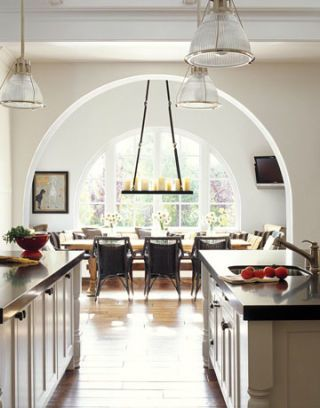 large kitchen with curved archway and large dining table