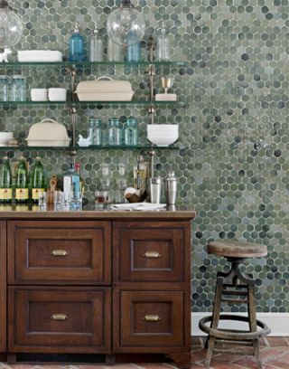 a sideboard against a tile wall
