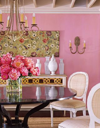 pink dining room with pink flowers on table