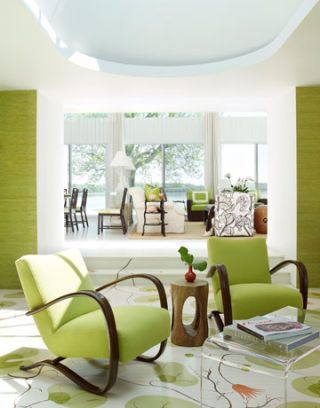 two green chairs in a light-filled room