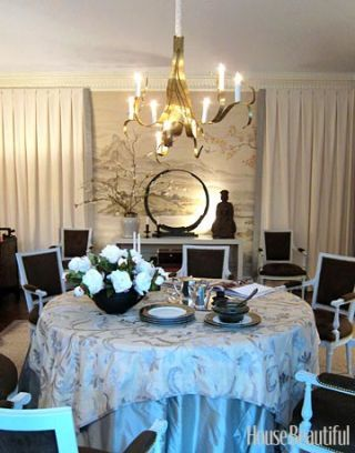 dining room with black chairs white curtains and hand painted wall paper