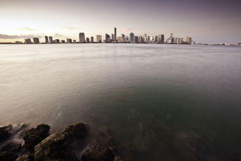 City, Tower block, Liquid, Fluid, Metropolis, Horizon, Urban area, Waterway, Cityscape, Metropolitan area,