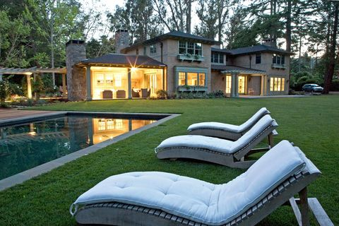 Window, Property, Residential area, House, Tree, Real estate, Home, Swimming pool, Lawn, Outdoor furniture,