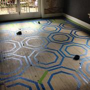 Floor, Flooring, Tile, Fixture, Tile flooring, Circle, Building material, Shadow, Daylighting, Flagstone,