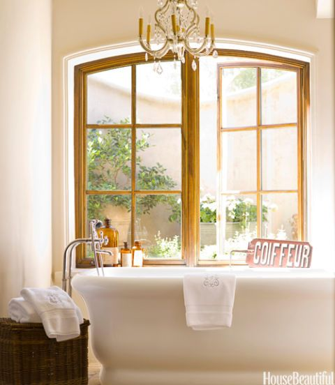 White Tub Sitting Beneath Window Elegant Bathroom
