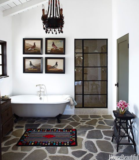 bathroom with chandelier and stone floor