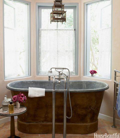 Pink Blue Patina Bathroom With Tub Next To Three Windows