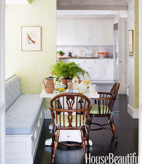 L Room With Green Walls And Blue Chairs