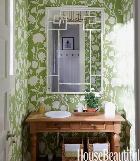 green and white wallpaper in room with sink