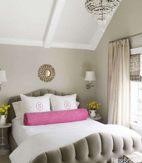 tufted headboard with pink pillow