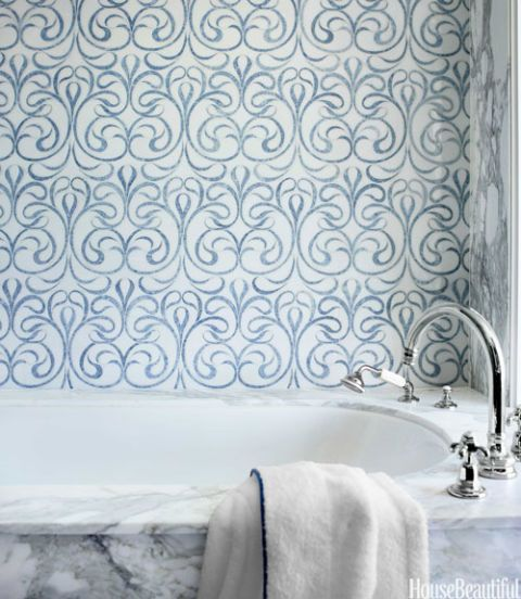 Blue and white thassos marble tile statement wall in a bathroom.