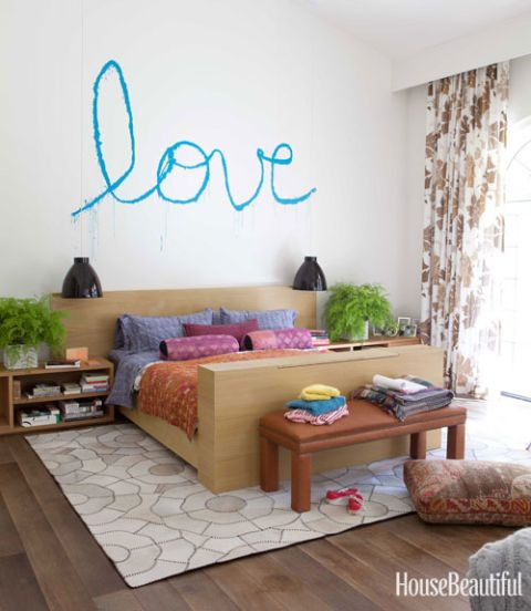 spray paint artwork on bedroom wall