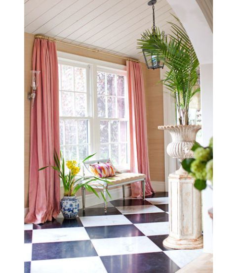 pink curtains in marble floored foyer