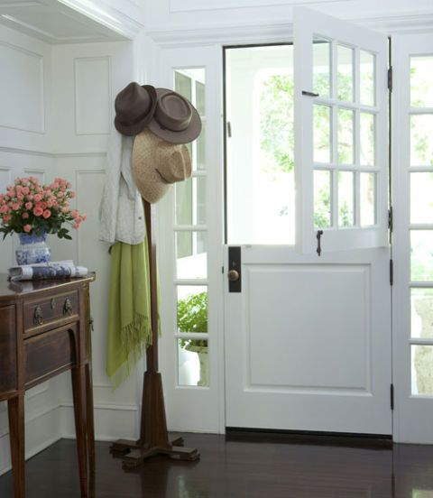 foyer with dutch door and coat rack