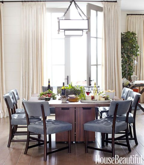 a gray and off white dining room with wood accents