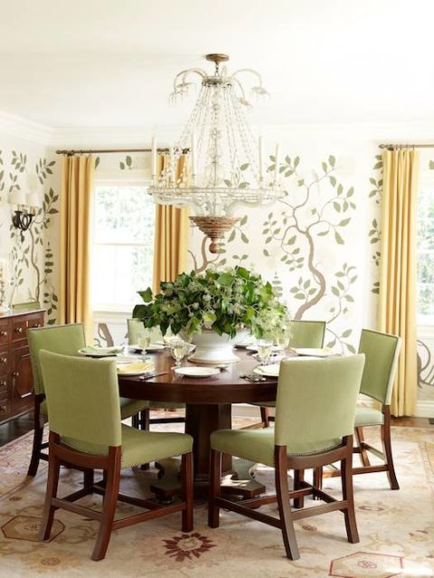Circular Wooden Dining Table With Wallpaper And Chandelier