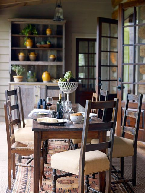 mix and match antique chairs around rustic dining table with sunlight