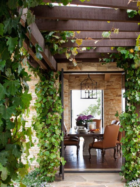 vines covering doorway to a pavilion to the dining room
