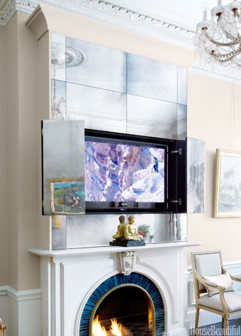 A Custom Mirrored Cabinet Above Mantel Hides Television In This Living Room Designed By Nina Farmer