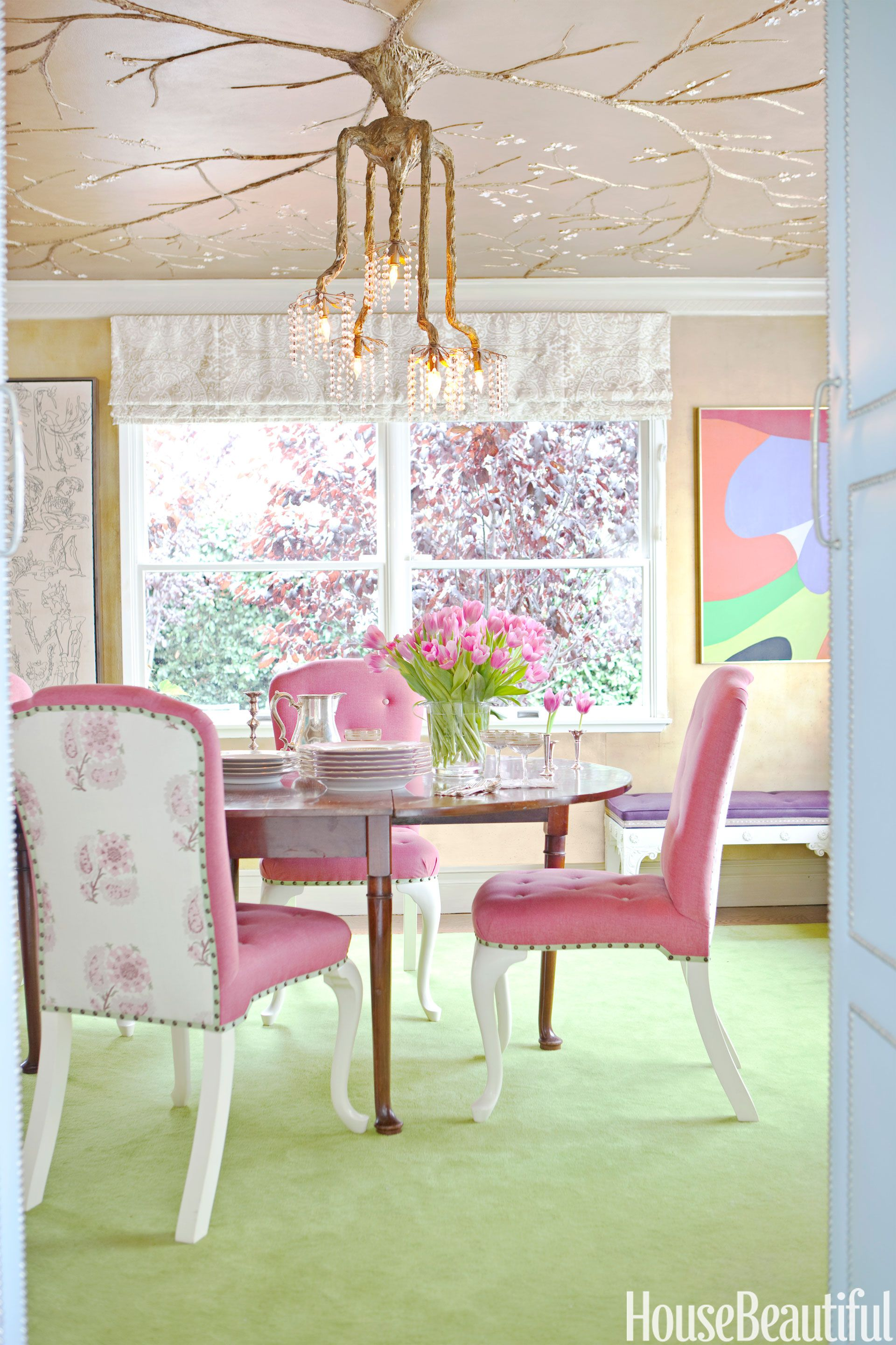 dining room with pink chairs and green floor