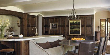 wood paneled kitchen with french zinc topped table