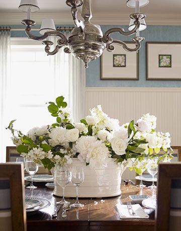 white flower arrangement on dining room table