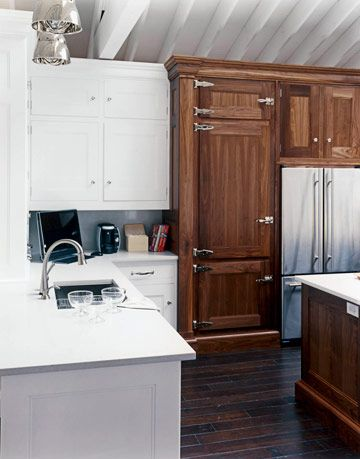 sink refrigerator and cabinets inside the kitchen of the year