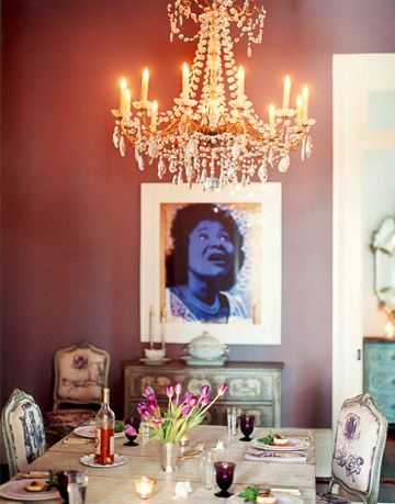 a silkscreen of New Orleans born gospel singer Mahalia Jackson and Louis XV chairs upholstered in toile make this room luxurious.