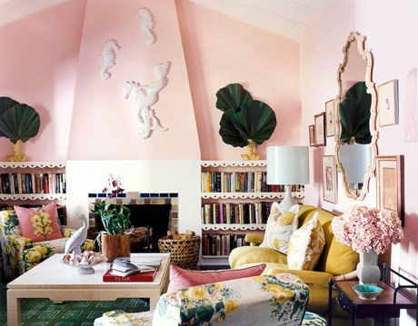 pink living room with sofa and chairs