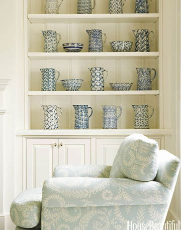 blue and white chair in front of wall shelves