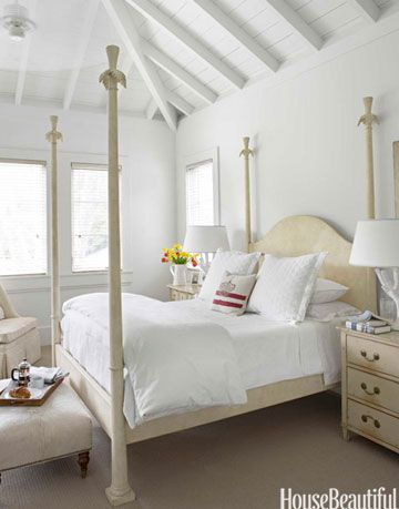 white room with white bed