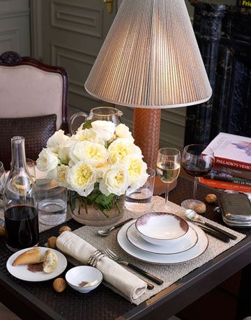 table setting with lamp flowers and wine glasses