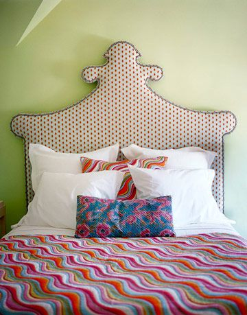 bed with headboard quilt and pillows
