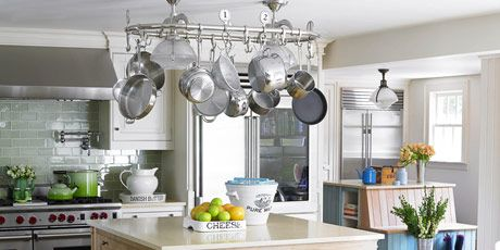 kitchen with hanging pots and three islands