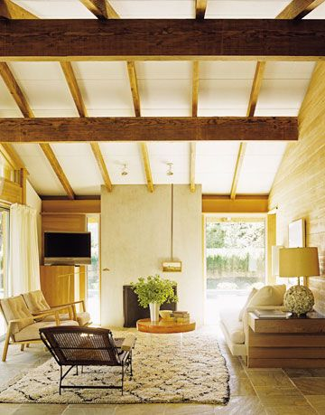 living room with exposed beams on the ceiling