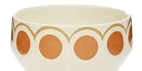 white bowl with orange circles