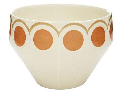 white bowl with orange circles