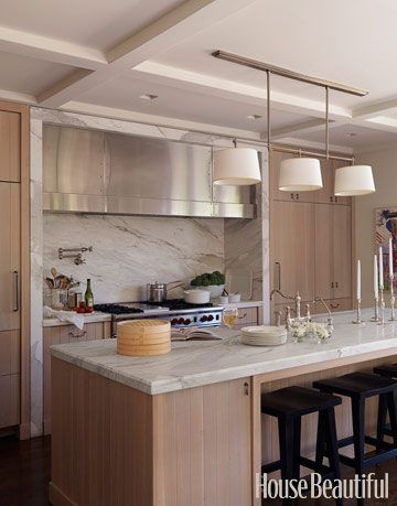 oak kitchen with black stools and white marble