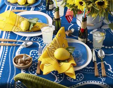 table setting with blue yellow and white accessories