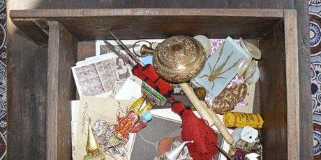 junk drawer with trim and other objects