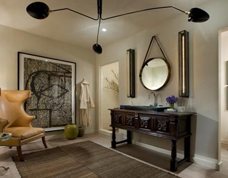 bathroom with seating and artwork
