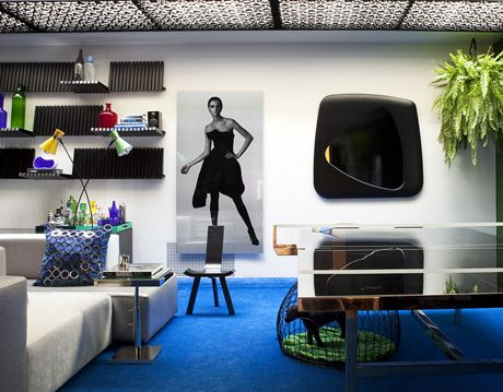 room with white walls black white and blue elements decorating it