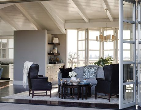 a gray and blue living room with sliding walls