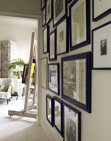 wall with black framed photos