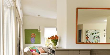 mirror above a fireplace