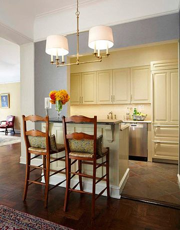 cream colored kitchen with counter bar