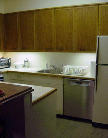 old dark kitchen with wooden cabinets