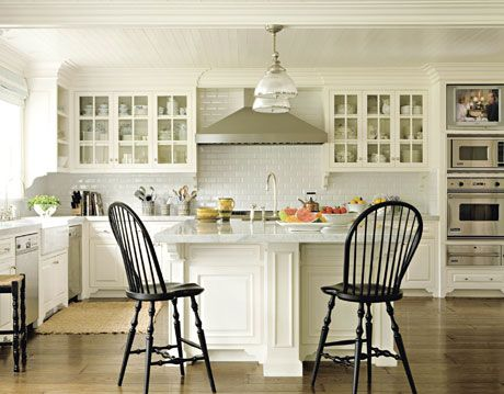 white kitchen with two black chairs